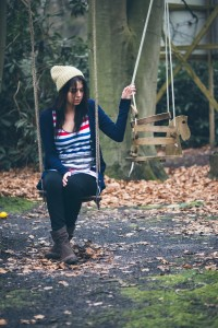 Lonely woman sitting on the swing